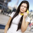 Woman with a banana phone — Stock Photo #10181663