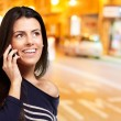 Royalty-Free Stock Photo: Young woman talking on mobile at night city