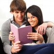 Couple reading book — Stockfoto #10182135