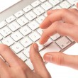Man typing on a keyboard — Foto de Stock