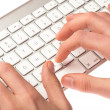 Man typing on a keyboard — Stock Photo