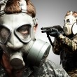 Young soldiers wearing gas mask over grey background — Stock Photo #10182504