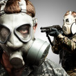 Young soldiers wearing gas mask over grey background - Stok fotoğraf