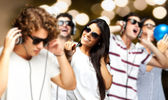 Portrait of young having a party against a golden lights — Stock Photo