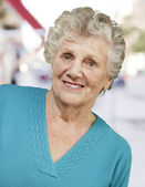 Portrait of senior woman standing at city — Stock Photo