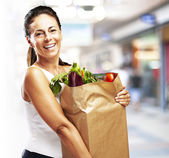 Woman with purchase — Stock Photo