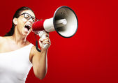 Woman shouting using megaphone — Stock Photo