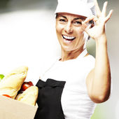 Woman carrying food — Stock Photo