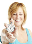 Woman holding stopwatch — Stock Photo