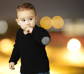 Portrait of adorable kid thinking at city by night — Stock Photo