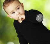 Portrait of adorable kid thinking against a nature background — Stock Photo