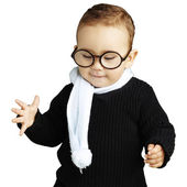 Portrait of kid wearing glasses looking down against a white bac — Stock Photo