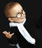 Portrait of adorable kid gesturing doubt against a black backgro — Stok fotoğraf