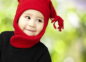 Portrait of an adorable kid smiling wearing winter clothes — Stock Photo