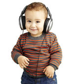 Portrait of a handsome kid listening to music and smiling over w — Stockfoto