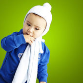 Portrait of serious kid thinking with the finger on his mouth ov — Stock Photo