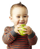 Portrait of funny kid holding green apple and smiling over white — Stock Photo