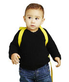 Portrait of adorable kid carrying yellow backpack over white bac — Stock Photo