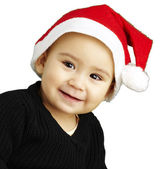 Portrait of happy kid wearing a christmas bonnet over white back — Stock Photo