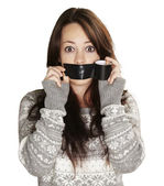 Portrait of scared girl being silenced by herself over white bac — ストック写真