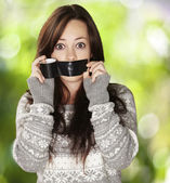 Portrait of scared girl being silenced by herself against a natu — Stock Photo