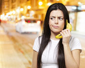 Woman with a banana phone — Stock fotografie