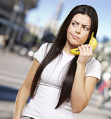 Woman with a banana phone — Stock Photo