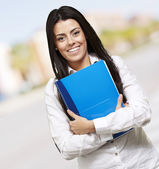 Woman holding a notebook — Stockfoto