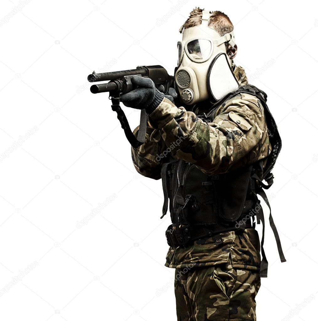 Portrait of young soldier with gas mask aiming with shotgun — Stock Photo #10180030