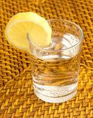 Glass and lemon — Stock Photo
