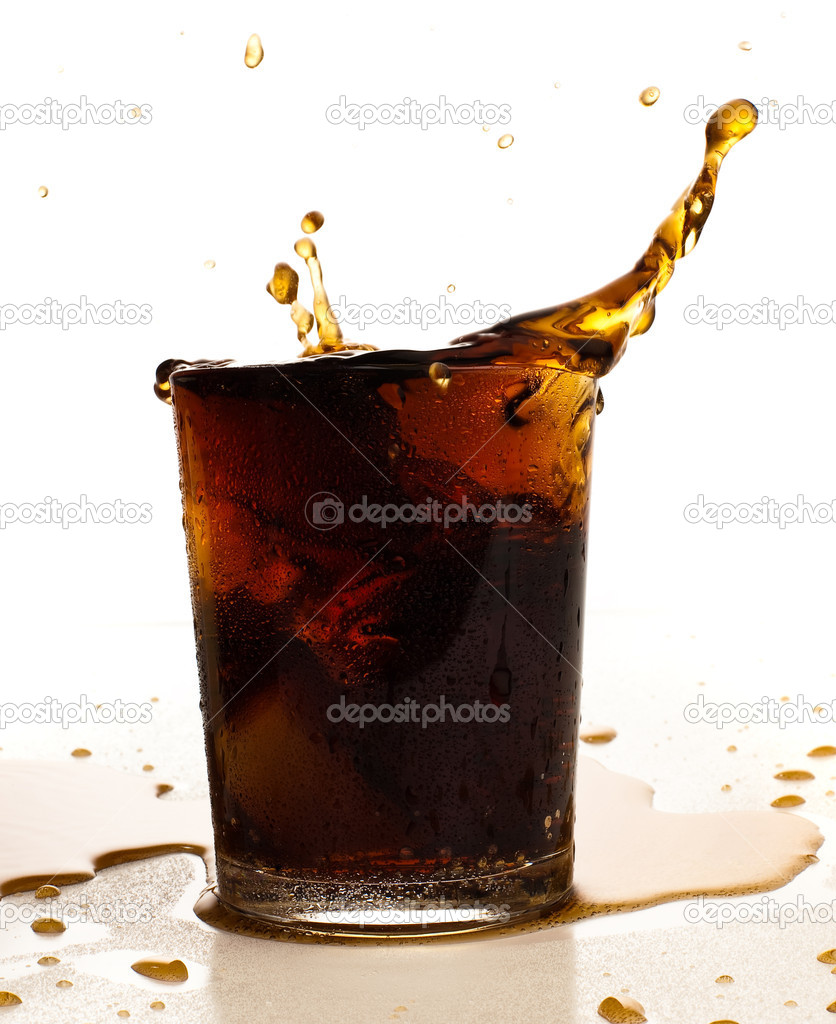 Brown refreshment splashing into glass on white  Stock Photo #10194971