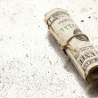 Stock Photo: Rolled dollar
