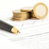 Euro coin and pen — Stock Photo