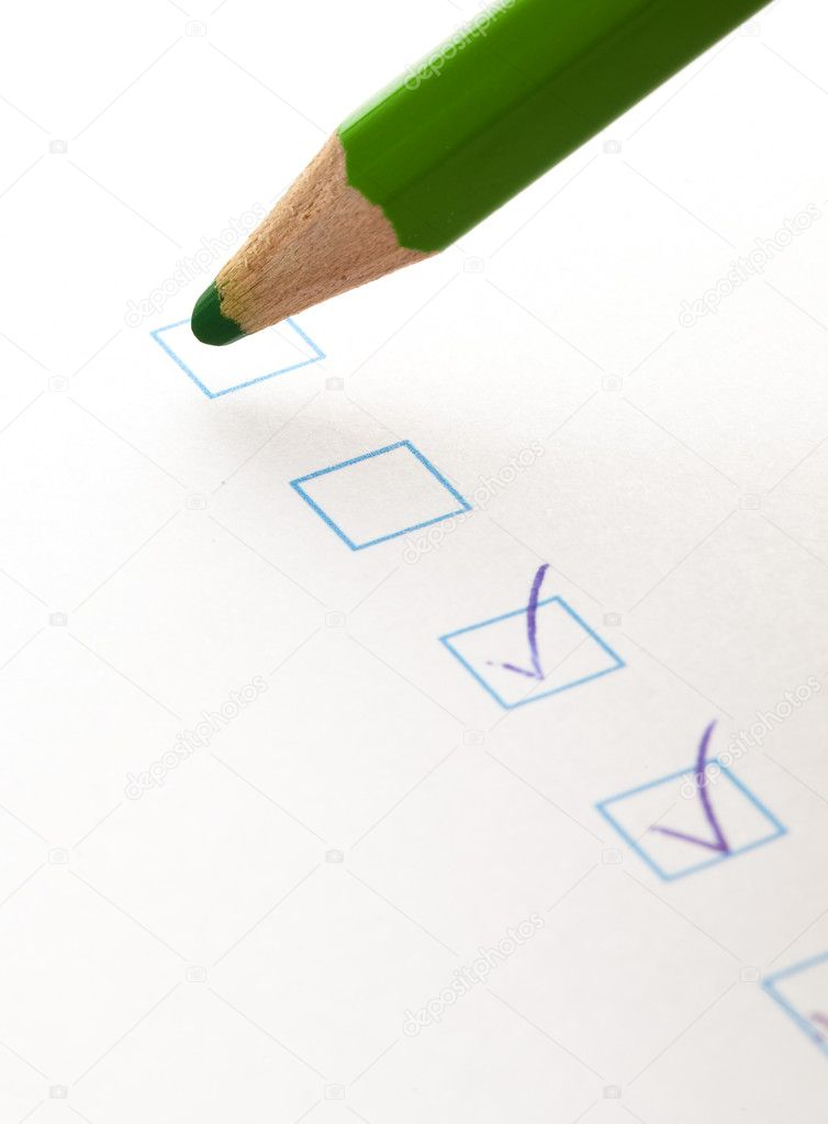 Test check box and green crayon, closeup photo — Stock Photo #10387087