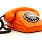 Vintage orange telephone over white background — Stock Photo