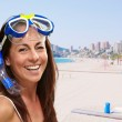 Portrait of a happy middle aged woman wearing snorkel and goggle — Stock Photo #10404212