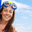 Portrait of a happy middle aged woman wearing snorkel and goggle — Stock Photo #10404230