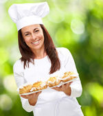 Portrait of pretty middle aged cook woman against a nature backg — Stock Photo