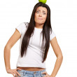 Portrait of young woman holding green apple on her head over whi — Stock Photo