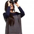 Portrait of young girl looking through a binoculars over white — Stock Photo #10582571