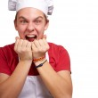Portrait of young cook man screaming over white background — Stock Photo #10582891