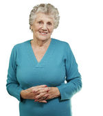 Portrait of senior woman standing over white background — Stock Photo