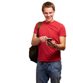 Portrait of young man touching mobile screen over white backgrou — Foto Stock