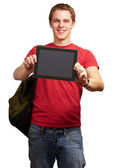 Portrait of young man holding a digital tablet over white backgr — Stock Photo