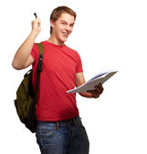 Portrait of handsome student holding notebook and pen over white — Stock Photo