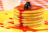 Pancakes with syrup and sour cherries — Stock Photo
