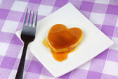 Mini heart-shaped pancake with syrup — Stock Photo