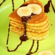 Heart shaped pancakes with chocolate sauce and banana — Stock Photo