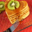 Stock Photo: Stack of heart-shaped pancakes with syrup and kiwi fruit