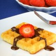 Waffle with chocolate and strawberry — Stock Photo #10728769